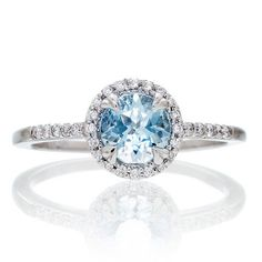 6mm Version 14 Karat White Gold Diamond Halo Round Aquamarine Engagement Ring. This is my engagement ring and it's perfect!