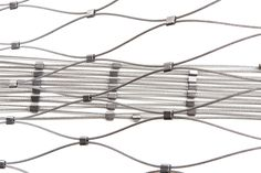 METAL MESH These cable networks are a metal mesh material made of loose stainless steel cables connected to each other with stainless steel terminals.