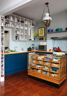 """Repurposed haberdashery cabinet with toughened glass top becomes a great """"island"""" with superb storage opportunities & worktop.  wEclectic Kitchen by Alison Hammond Photography"""