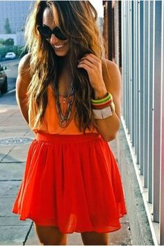 Summer is going to be exploding with color. Love this red skirt paired with the orange tank.