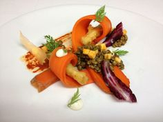 salt-baked carrot salad, served with roasted garlic, lentils and harissa
