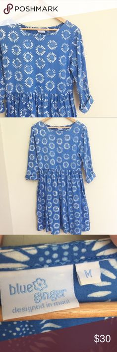 """Hawaiian blue ginger dress Incredibly sweet babydoll dress. I ordered this dress off poshmark and it is just a bit to big for me. It is blue with white sunflower print throughout. Full length sleeves that can be rolled up. It's in great condition. No sign of wear. It is 100% cotton size medium. 37"""" in length and 20"""" pit to pit. Made in Hawaii🌺 Dresses"""