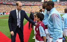 Prince William, Duke of Cambridge greets Aston Villa players and mascots during the FA Cup Final