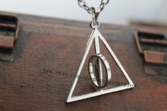 the harry potter jewelry spin Deathly Hallows on Etsy, $3.03 CAD