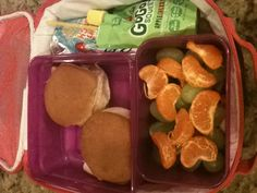 Great school lunch for kids(especially kids with braces)-2 turkey sandwiches, layered fruit(strawberries, grapes, oranges) a squeezy applesauce, and a juice. YUM!!!