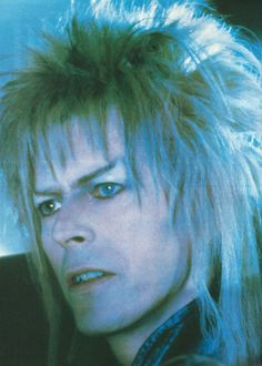 labyrinthnook: Here's a great shot of Bowie as Jareth from Labyrinth. This is my scan from a clipping - I'm vastly amused by the fact the other side of the clipping features an ad for a film titled Eat The Peach - it's quite the in-joke, when you think about it.