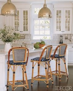 navy & white french bistro chairs, gold light fixtures, beautiful white kitchen....love it all