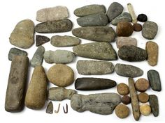 Dealer lot of stone celts and various other Native American stone artifacts. Most carry labels indicating they were f.