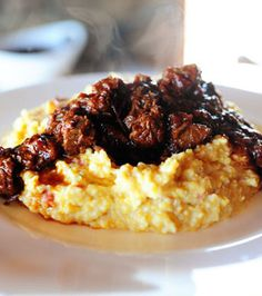 Spicy Stewed Beef with Creamy Cheddar Grits, this decadent meal will put a smile on your man's face! @Reena Dasani Drummond | The Pioneer Woman #manfood #grits
