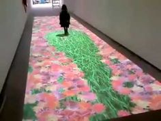 A prototype of a rug that changes pattern as you walk over it. This is so cool looking!