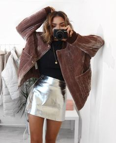 Mix textures for a luxe holiday outfit, like this high shine metallic miniskirt and fuzzy faux fur jacket