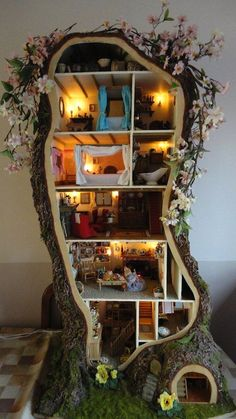 How amazing! I wish I had the skills to make something like this! So cute! I always wanted a doll house when I was little but this is a house made for magic fairies.