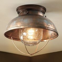Silver bowl turned light fixture