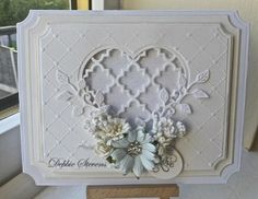 Hello everyone,Ive dug out one of my papertrey die called quatrefoil, along with Spellbinders de lites vines of passion (heart), SB grand labels, Sue Wilson heart lattice embossing folder, SB frame...