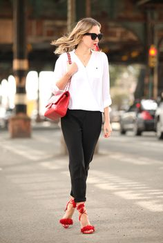 spring / summer - street style - street chic style - summer outfits - casual outfits - work outfits - office wear - business casual - white surplice blouse + black ankle pants + red suede tassel heeled sandals + red shoulder bag + black cat eye sunglasses