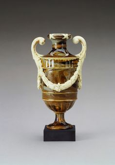 Wedgwood & Bentley: Etruria (c. 1768-80), White terracotta stoneware, on black 'basalt' base, 16.5 x 8.5 x 6.7 cm - Acquired by Queen Mary, consort of King George V, King of the United Kingdom (1867-1953), when Queen Consort (1910-36) - Royal Collection Trust