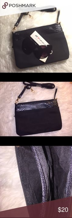 NWT Black Clutch Wristlet Purse & Detachable Strap Small black purse that can be worn as a clutch, Wristlet, a shoulder purse or a cross body bag. Super cute, convenient, versatile and has 1 outside pocket and one inside, zip closure pocket. New with tags. Reptile like detail. Vegan leather.Super chic, classic and trendy. Will fit your wallet, keys, phone, makeup and other essentials. 🎉🎉Offers accepted.Bundle and save. 🎉🎉 Bags Clutches & Wristlets