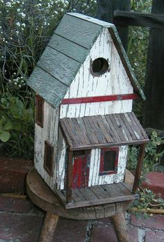 Birdhouse with a front porch and a second story * Schoolhouse Country Gardens *