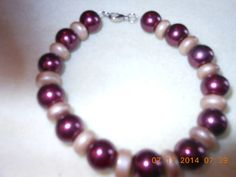 Bracelet Large burgundy round beads and rondelle tan beads