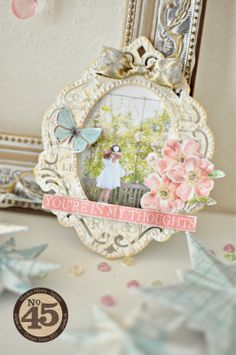 I add a bow using the Graphic45 washi tape on the frame.