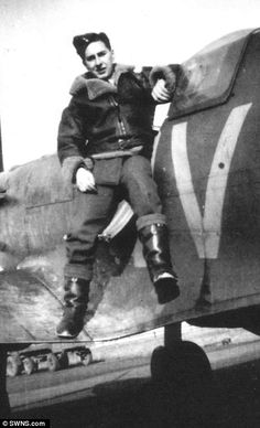Pilot Ken Wilkinson, who is pictured with the Spitfire he flew during the Second World War...