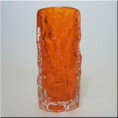 "Whitefriars tangerine glass cylindrical 6"" 'Bark' vase, from the 'Textured' range, designed by Geoffrey Baxter, pattern number 9689."