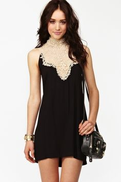 Super cute black dress featuring a plunging cream crochet neckline with metallic gold threading. Open back with tie detail, flowy fit.