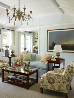 In the living room of one of the cottages, the sisal and linen diamond-patterned rug suggests a relaxed feeling, and the palette is filtered and softened compared to the main house, but the furnishings and art are no less humbly elegant. Sky blue walls set off distinctive details like a pair of zinc star finials and a grass-cloth panel in the coffee table top.