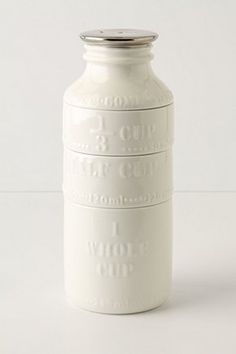 Adore this milk bottle measuring cup set. Useful & a fun statement piece! #kitchen #white #china