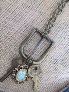 Vintage Buckle Necklace with Keys and Gold Flower Medallion. As featured in Country Living Magazine.. $28.00, via Etsy.