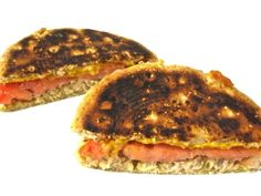 Grilled Tuna Melt Made Skinny. It makes a super quick and easy lunch or dinner and is absolutely delicious!  Each skinny melt has 283 calories, 9 grams of fat, 6 grams of fiber and 7 Weight Watchers POINTS PLUS. http://www.skinnykitchen.com/recipes/grilled-tuna-melt-made-skinny%E2%80%A8%E2%80%A8/