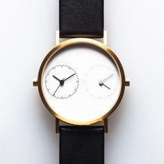 Two time machines in one! Original description: Long Distance 1.0 (gold) by  Kitmen Keung. Available at Dezeen Watch Store: www.dezeenwatchstore.com #watches