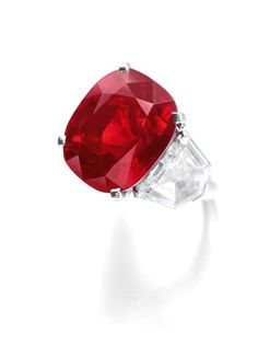 'The Sunrise Ruby' A superb and extremely rare ruby and diamond ring weighing 25.29 carats, Cartier