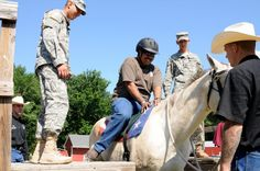 'Old Guard' Soldiers, horses assist wounded warriors with therapeutic riding | Article | The United States Army
