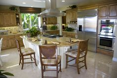 This eat-in kitchen has stainless steel appliances and a gorgeous tile backsplash.