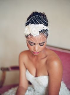 Fascinators can be great on the beach because you don't have to worry about a veil blowing away:)