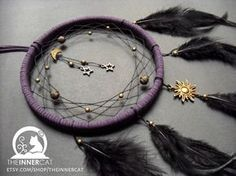 Dream Catcher 8 inches in diameter. Wrapped in hand-cut strips of black buckskin leather. Very detailed. The outer edge of the web is beaded with bone and glass beads. The inside of the web is bead...