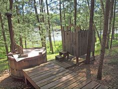 A 128 square feet lake tiny house on stilts with wood-fired hot tub in Gordon, Wisconsin.