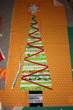 The Q and the U - Quilting Blog: Goodbye Halloween, Hello Christmas: Selvage Tree in Progress
