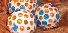 Garden Mosaic Balls by Peggy Banks - styrofoam ball, hot glue gun, flat-bottom glass beads, sanded grout, damp sponge, grout sealer. Glue beads onto styrofoam ball. Mix grout a little thick. Rub grout in with damp sponge. As it dries, wipe off beads with the sponge. Rinse in a bucket often. (Not in a sink!) Seal with a grout sealer.