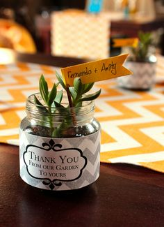 Clippings from your own succulent garden in baby food jars create awesome favors so guests can enjoy part of your wedding day for years to come | Offbeat Bride