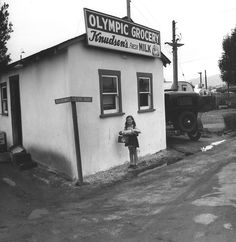 The Olympic Grocery, a small market at the Olympic Trailer Court. Photographed by Ansel Adams in 1940.