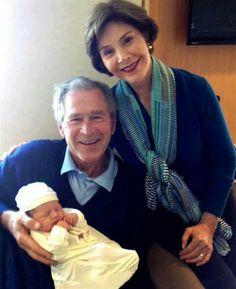 Former President George Bush, wife Laura and new grandbaby