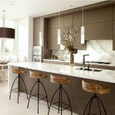 great island design, also love the more modern kitchen style contrasted with the rustic stools