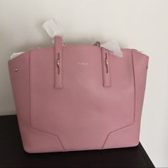Furla Perla medium tote bag in pink Genuine leather bag with top zip closure and two handles, lined interior and slip pocket. Never been used, comes with dust bag and box. Furla Bags Totes