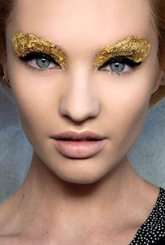 love the black liner against the gold and the blue of her eyes