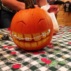 These Pumpkins Are Better Than Yours — But There's Still Time #refinery29  http://www.refinery29.com/pumpkin-carving#slide-11  We'd be so happy if we looked half as cute with braces....