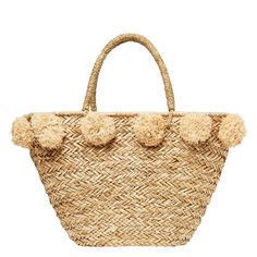 Straw bag with inner zip closure and oversized pom poms.