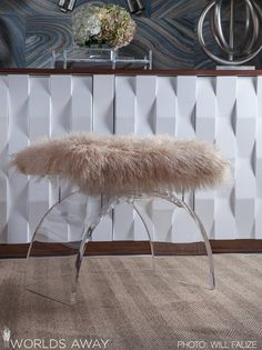 Lucite & fur never looked so good! Our Marlow arched stool with natural Mongolian fur cushion.