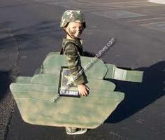 cardboard box tank costume for kid for a Mini-Logan... except a USMC tank not no Army tank business! ;)
